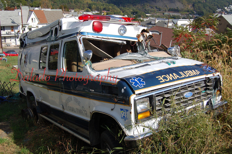 A 1990s Ford Ambulance that has seen better days.