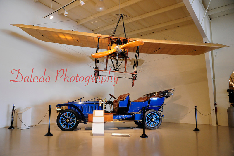 A 1903 Mercedes Simplex Tourer is seen under a plane at OHT.