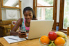 TA7.5 / Is multitasking, which involved divided attention, beneficial or distracting / Requested new photo of teenager engaging in media multitasking<br /> <br /> Choice 8 of 14<br /> <br /> Atlanta, Georgia, USA --- African American female teen texting --- Image by © Ocean/Corbis