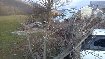 Some of the trees that were knocked over.  That's my old 1989 Subaru under the trees.  Early Saturday morning.