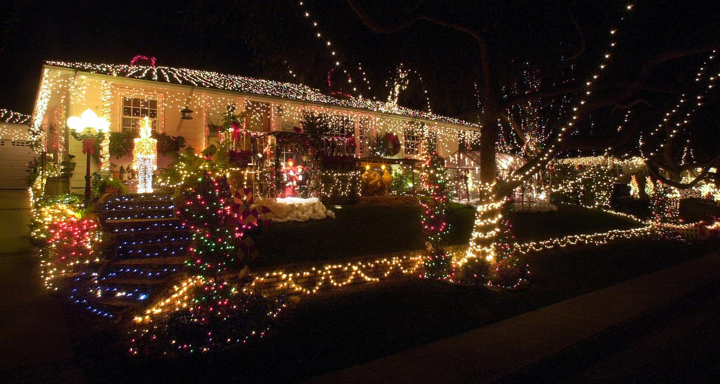 """. Breeze photo by Bruce Hazelton - 12/6/00 - Chrstmas lights a light up home on Carol Dr. in \""""Sleepy Hollow\"""", an area of homes in South Torrance that has a tradition of elaborate light displays."""