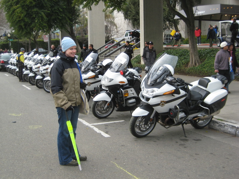 Mellie fighting the temptation to pull a PeeWee Herman move with the line of cops' bikes!