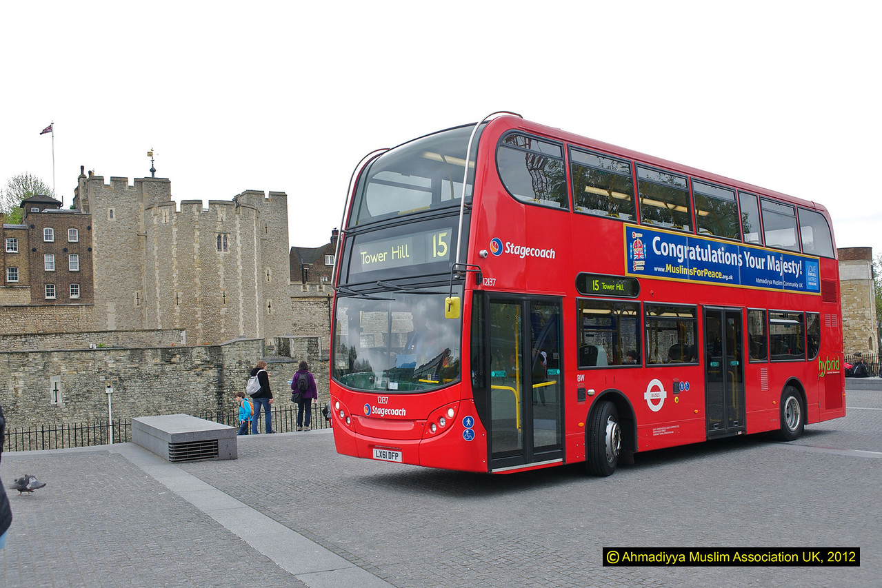 Jubilee/Message of peace bus outside Tower of London. The bus itself is one of the latest Hybrid type