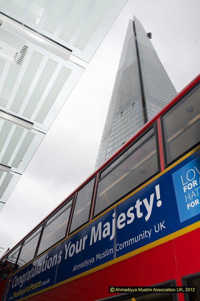 The Jubilee message bus with The Shard aboveit. The Shard is a pyramid-shaped skyscraper in London and is the tallest building in Europe. When fully completed it will 72 floors and will be clad fully in glass. Expected to be open to the public in July 2012