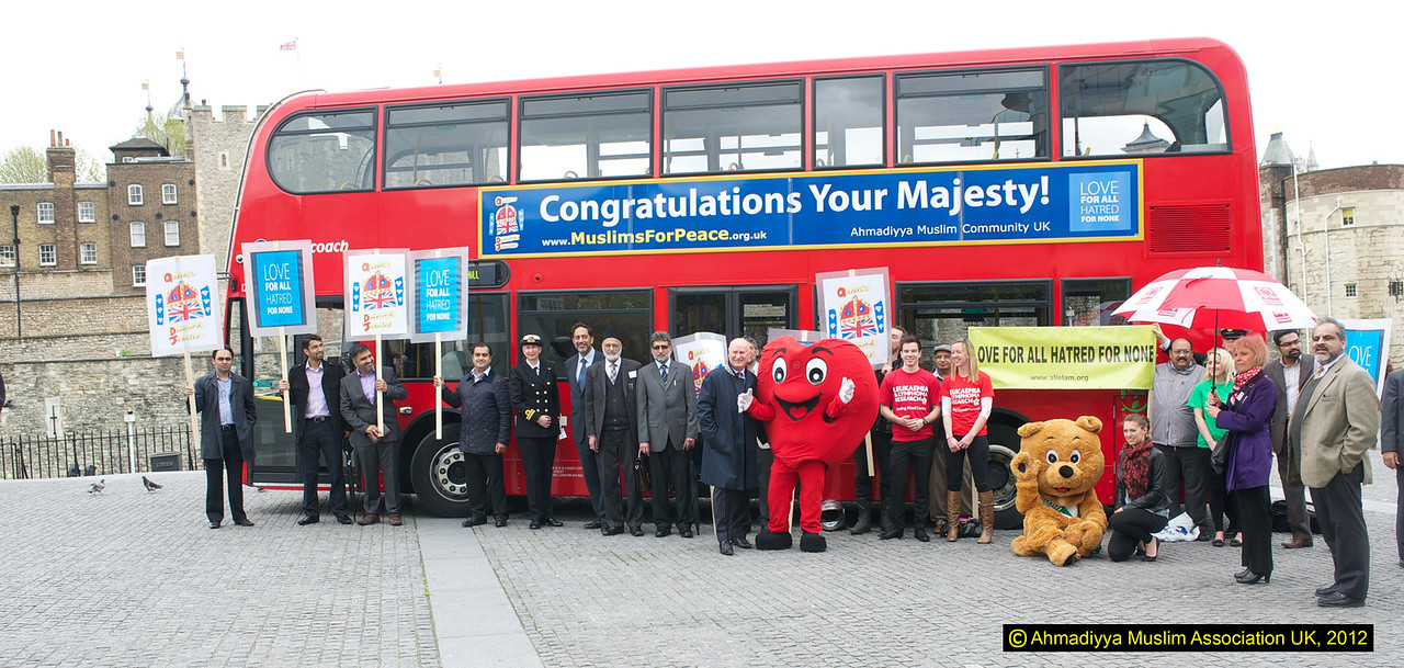 Members of  the Ahmadiyya Muslim community UK and some of the charities that money is being rasied for outside the Tower of London. The Charity walk will take place at the Tower on 13 May 2012