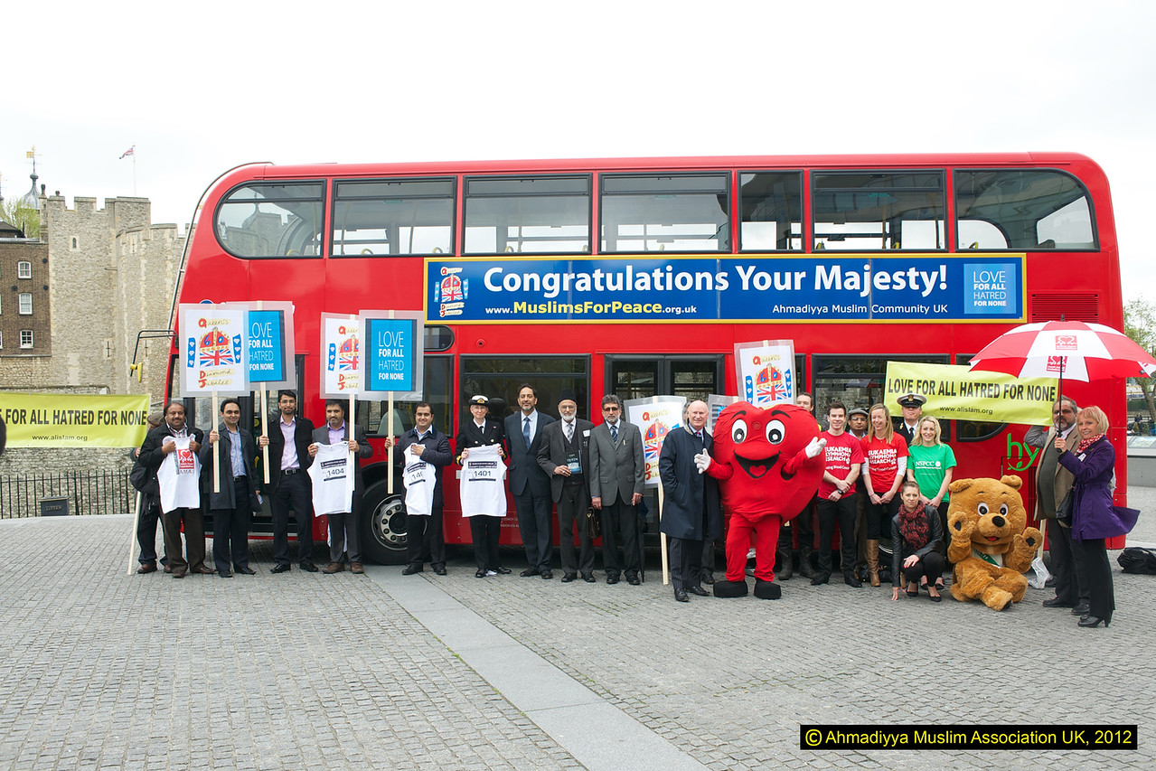Members of the Ahmadiyya Muslim community and some of the charities that money is being rasied for outside the Tower of London. The Charity walk will take place at the Tower on 13 May 2012