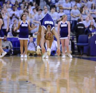 Georgetown Cheerleader doing summersaults down the court