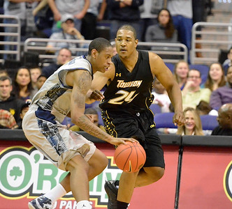 Georgetown's Greg Whittington and Towson's Bilal Dixon