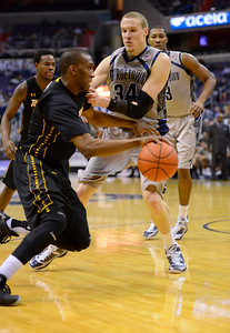 Towson's Marcus Damas drives baseline on Georgetown's Nate Lubick