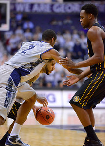 Towson's Mike Burwell drives as Georgetowns Greg Whittington fights his way past a pick