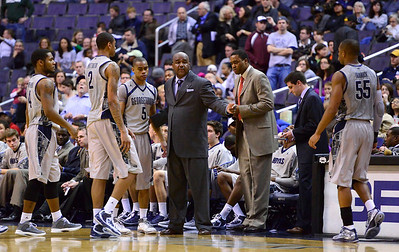 Coach John Thompson III, brings his team over during closing 2nd half action at the Verizon Center