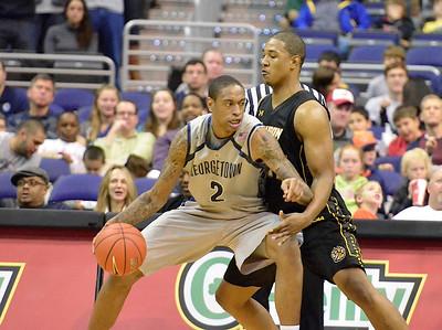 Bilal Dixon guards Georgetown's Greg Whittington (#2)