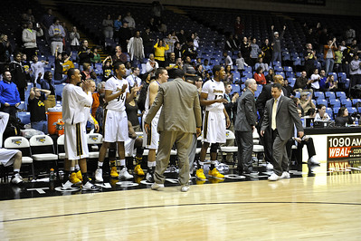 Coach Pat Skerry, a smile on his face walks down the bench. Towson players finally have something to cheer about, as well as the fans.