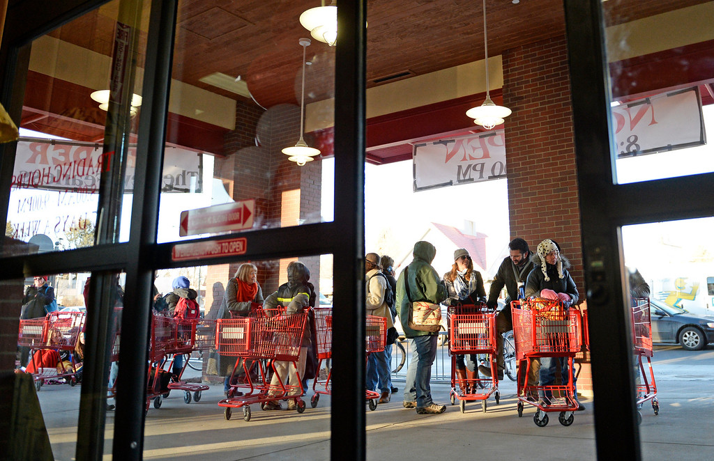 . People line up for the grand opening of specialty grocer Trader Joe\'s located on Colorado Blvd. and East 8th Avenue in Denver, February, 14 2014. Two other Trader Joe\'s locations in Colorado will also open today. (Photo by RJ Sangosti/The Denver Post)