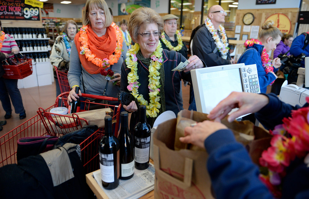 . Cindy Turner, center, drove all the way from Edgemont, South Dakota to come the new Trader Joe\'s, located on Colorado Blvd. and East 8th Avenue in Denver, for the grand opening of specialty grocer, February, 14 2014. Turner has been planning the trip for 6-months. Two other Trader Joe\'s locations in Colorado will also open today. (Photo by RJ Sangosti/The Denver Post)