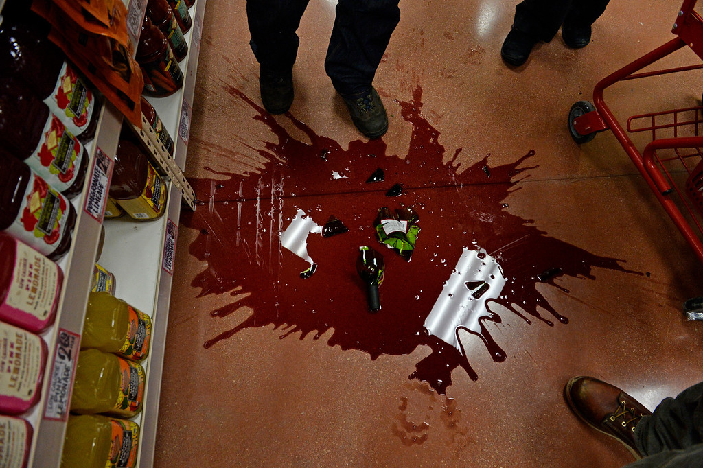 . A bottle of wine never made it home during the grand opening of the new Trader Joe\'s, located on Colorado Blvd. and East 8th Avenue in Denver, February, 14 2014. Two other Trader Joe\'s locations in Colorado will also open today. (Photo by RJ Sangosti/The Denver Post)
