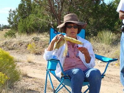 Norma Duran enjoys the fresh roasted corn sample.