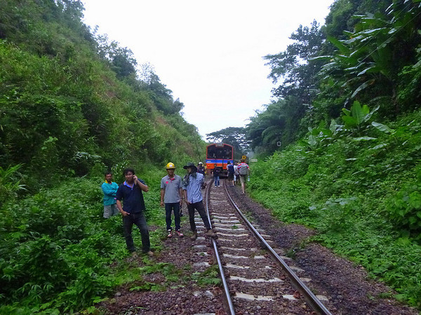 A Thai rescue team finally evacuates us after our train derailed en route from Bangkok to Chiang Mai, Thailand.