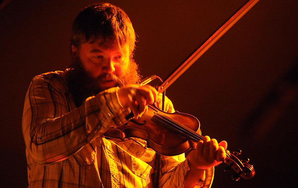 Trampled By Turtles fiddle player Ryan Young perfumes during the band's concert Wednesday at the Verizon Wireless Center. Pat Christman
