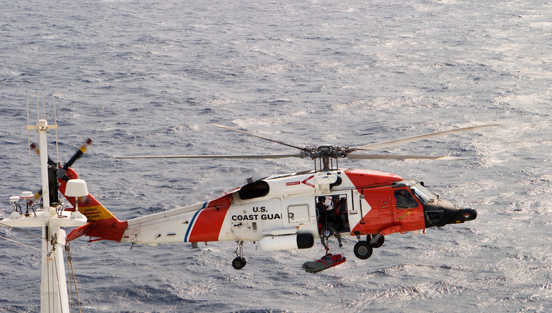 A helicopter rescue mission. This was not a drill as a cruise ship's passenger was being evacuated on a stretcher as a crewman reaches out.