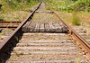 A pair of railroad tracks stretching off in a dtraight line o infinity. This kind of image is symbolic to many linked activities in business duch as receding goals, etc.