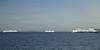 Three ferry boats are crossing paths while on their regular runs from Seattle to the Olympic Peninsula.