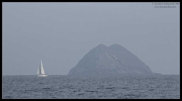 Random sailboat in the Pacific ocean, with Islas Coronados, Mexico in the background, Whale Watching trip on 'America' sail boat, September 2011