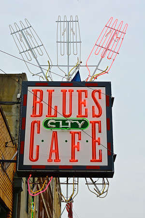 "Blues City Cafe opened in March of 1991 under the name of ""Doe's Eat Place"". Doe's was originated in Greenville Mississippi by owners Charles and Dominic (Doe) Signa. George Eldridge was brought in as the owner in Memphis and ran Doe's for 2 years during a push for business in downtown Memphis, particularly Beale Street. In the early 90's, Blues City Cafe developed a menu and consistent items that would work for the Memphis and Beale Street locals, tourists, etc. Ribs became the focal point, as they are today, and other items were added over the years, such as our steaks, catfish and tamales. In October of 1993, investors bought Doe's and changed the name to Blues City Cafe. Many of the same faces that were with Doe's in the early 90's remain at Blues City Cafe today. Ty Agee and Jerry Bean for example, their consistency and constant drive to better our food quality and speed of service have made Blues City Cafe what it is today,  The #1 business at the #1 tourist attraction in Tennessee. Over the years we have had many special musical guests in our music venue at Blues City Cafe called the Band Box. Below is a list of just some of the musicians that have graced our stage:  Rufus Thomas BB King Ollie Nightengale Jerry Lee Lewis Albert King Little Jimmy King Reverend Al Green Hank Williams JR Sam Phillips Ike Turner The Cate Brothers Kid Rock Jim Dandy The Dirty Dozen Brass Band Ivan Neville Clarence ""Gatemouth"" Brown Keanu Reeves & Dogstar Levon Helm Memphis Horn - Wayne Jackson and Andrew Love Timmy King Denise Lasalle Booker T. Laury Phoebe Lewis The Masqueradors Willie Mitchell The Hi Rhythm Section	Courtney Love Queen Latifah R. Kelly David Porter R.L. Burnsides Savory Brown Smashing Pumpkins Charlie Musselwhite Carla Thomas Marvell Thomas Charlie Watts Jack White Jason D. Williams Yanni Leon Wilkeson & Lynrd Skynrd The Dempseys Free World Earl The Pearl Little G Weevil Miss Zeno American Hi Fi Los Lonely Boys Mark DeCarlo Richie Havens Big Jack Johnson  Here at Blues City Cafe we have had many interesting visitors, from the famous to the infamous, actors, politicians, musicians, authors, and sports figures. Here is a list of just a few of the famous that have enjoyed our eats: President Bill Clinton Robert Plant Steve Cropper Ben E. Keith Trent Reznor Buddy Guy Jesse Jackson Mayor Willie Herenton Mayor A C Wharton Mayor Jim Rout Rep. John Ford Rep. Harold Ford Sr. Rep. Harold Ford Jr. Steve Cohen Shelby Foote The Amazing Rhythm Aces Garrison Kellier Brent Humes Jim Jarmurch Milos Furman Sydney Pollack Keith Carradine Carol Channing Dave Chapelle	Jimmy Paige Duck Dunn Alice Cooper Little Milton Al Franken Tom Cruise Wilford Brimley Robert Duvall Robert DeNiro Woody Harrelson George Hamilton Elizabeth Hurley James Gandolfini James Earl Jones Ed Harris Nicole Richie Diane Ladd Conan O'Brien Steven Seagall Jerry Seinfeld Jeanne Tripplehorn Bill Murray Samuel L. Jackson Jerry West Too many players from the NBA to mention"