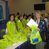 Mary picking up her shirt and drop bag with goodies at the Hynes Convention Center, Boston, MA