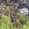 Chuck waving thru a lava hole.