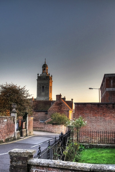 The sun goes down in Blandford giving the Georgian church tower a golden appearance.