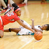 Don Knight / The Herald Bulletin<br /> Anderson's Donjanae Chamberlain and Pike's Aja Ladd fight for control of a loose ball on Thursday.