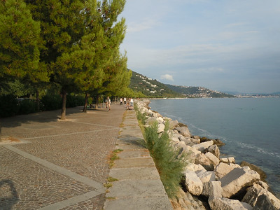 This terrace goes from the castle, all the way to the city of Trieste, some 5 miles away.  All along it people sunbathe and swim.  Many cafes offer a place to stop and get a drink or something to eat.
