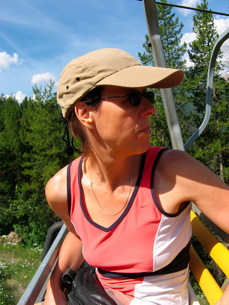 Hiker on Ski lift chair
