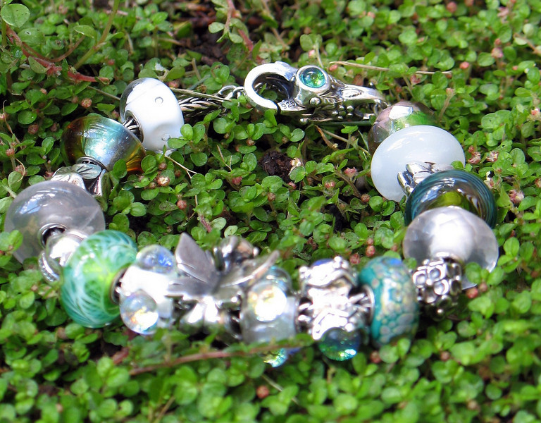 """Disappointing shot of my """"New Spring Growth Emerging Through the Snow"""" bracelet."""
