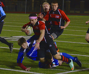 The Troy United men's club rugby team crushed Livonia, 69-12, Wednesday night on its home turf. (Photo gallery by Jason Schmitt of The Oakland Press)