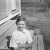 Dennis Truempi by the porch at Joe and Vernie Von Arx's house by Hokah, Mn.