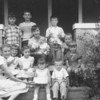 Lisa's 2nd or 3rd birthday<br /> Back row, left to right:  Rose Rita Truempi, Howard Sheehan, Pauline Truempi, (baby Mary Jane Hoskins?),Dicki Johnson?, Billy Hoskins and Mary Kay Sheehan<br /> Front row, left to right: Marie Truempi, Bonnie Hoskins, Mary Johnson?, Lisa Von Arx, and Mike Hoskins.<br /> - on the porch of Lisa's grandparents, Joe and Verna Von Arx.