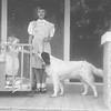 Rose Rita Truempi with baby Lisa Von Arx and family dog on the porch at Joe and Verna Von Arx farm, Hokah, MN.