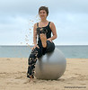 Tanya with a stability exercise ball kicking sand at Coogee Beach, Sydney in January 2010