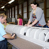 Don Knight/The Herald Bulletin<br /> Caleb Thomas judges rabbits at the 4-H Fair on Tuesday.