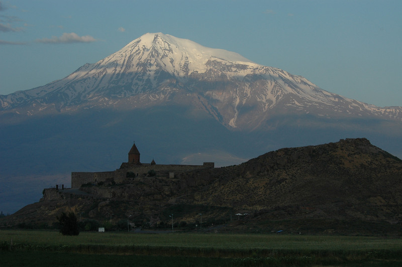 Khor Virap Monastery, in Armenia, foreground, and Mt. Ararat, Turkey, at dawn.
