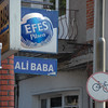 Efes is the Turkish national beer, as seen here on an advertisement at the Ali Baba restaurant, Eminonu district, Istanbul, Turkey.