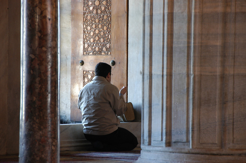 Prayer, the Blue Mosque, Istanbul, Turkey.