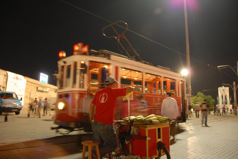 Selling corn on the trolley line, Taksim Square, Istanbul, Turkey.