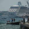 Kids and cruise ship on the Bosphorus Strait, Istanbul, Turkey