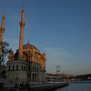 Sunset at the waterfront Ortakoy Mosque, built in 1853 - 1854, and the Bosphorus Bridge, completed in 1973, connecting Europe (near side) with Asia.