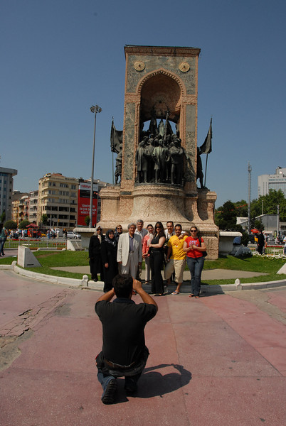 Portrait in front of the Republic Monument, Taksim Square, Istanbul, Turkey.