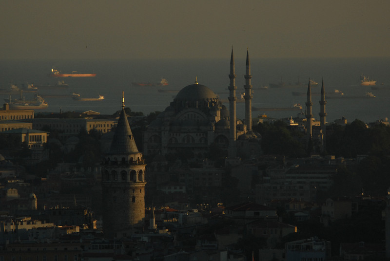 Sunset across the Galata Tower, foreground, and historic Istanbul, Turkey, across to the Sea of Marmara.