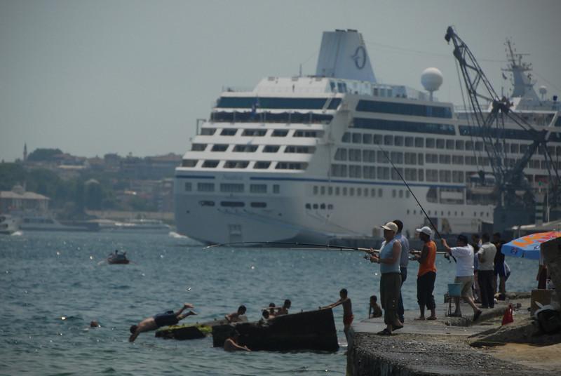Swimming, fishing and cruising, Istanbul, Turkey.